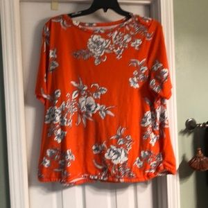 Orange top with flowers outlined in blue